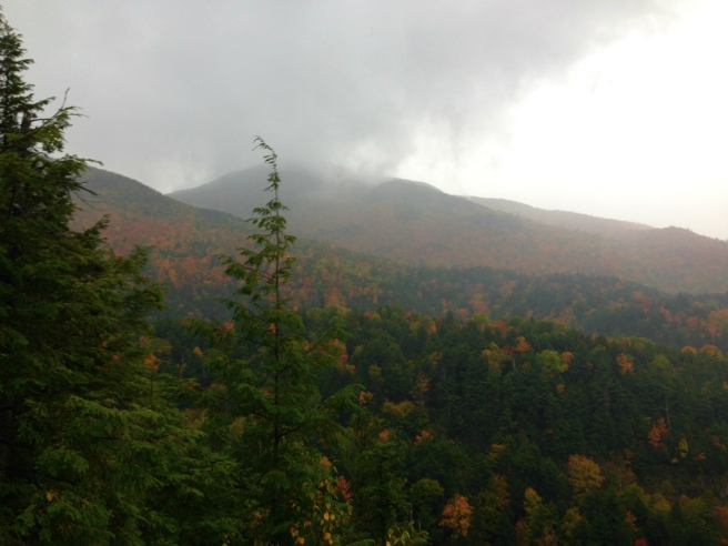 A view of some fog lifting over the mountains from the top of Roaring Brook Falls.