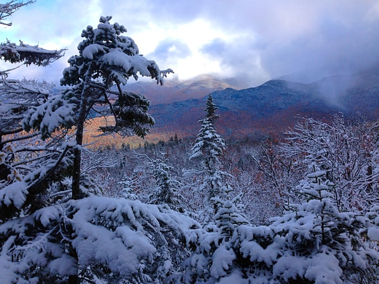 The fall colors of the Adirondacks were visible through the snow-covered trees on the trail to Street and Nye Mountains.