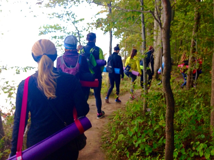 Hiking along the Bluff Trail during a Hikyoga™ event.